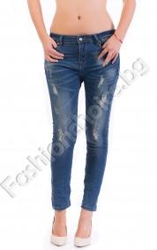 Изтъркани дамски джинси в деним с намачкан ефект