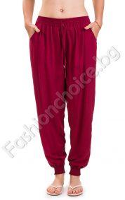 Едноцветен летен панталон с набор на глезените и джобчета