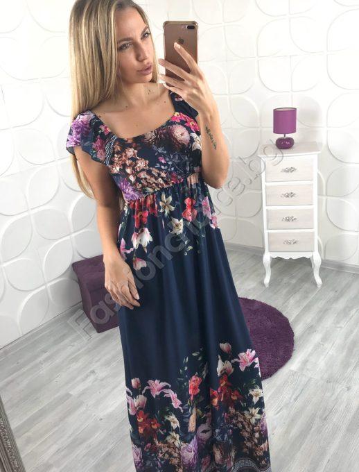 Грациозна дълга дамска рокля с гол гръб на цветя