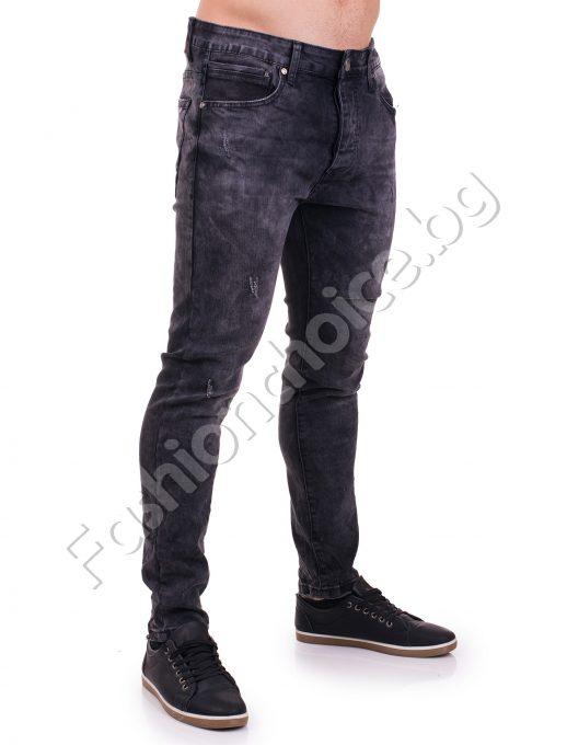 Модерни изтъркани мъжки дънки с леко надран ефект