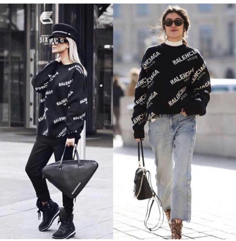 Черен дамски пуловер с надпис в актуална модна кройка