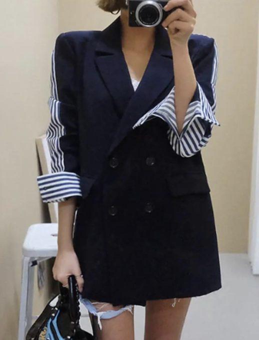 Спортно- елегантно сако в тъмно син цвят с интересен гръб на рае